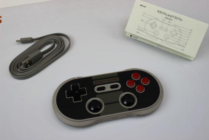 mando, cable USB y manual e instrucciones