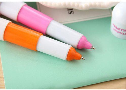 bolígrafos extendidos en rosa y naranja