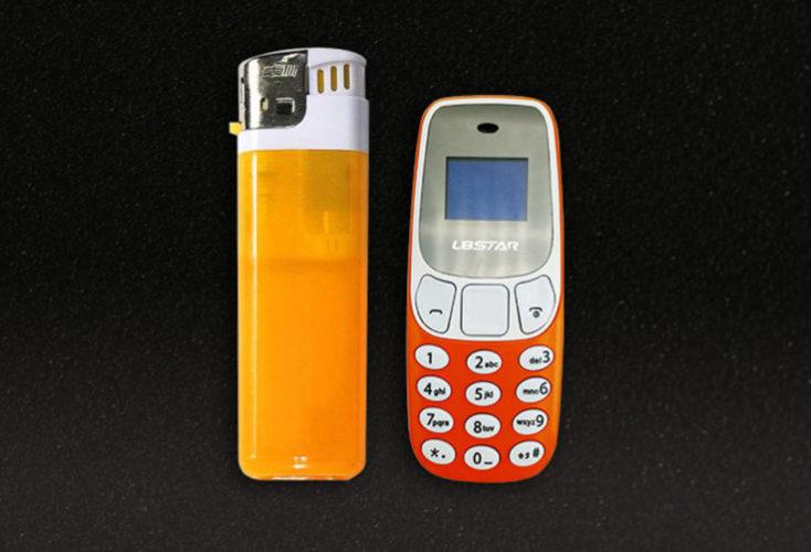 L8STAR BM10 Mini teléfono móvil al lado de un mechero