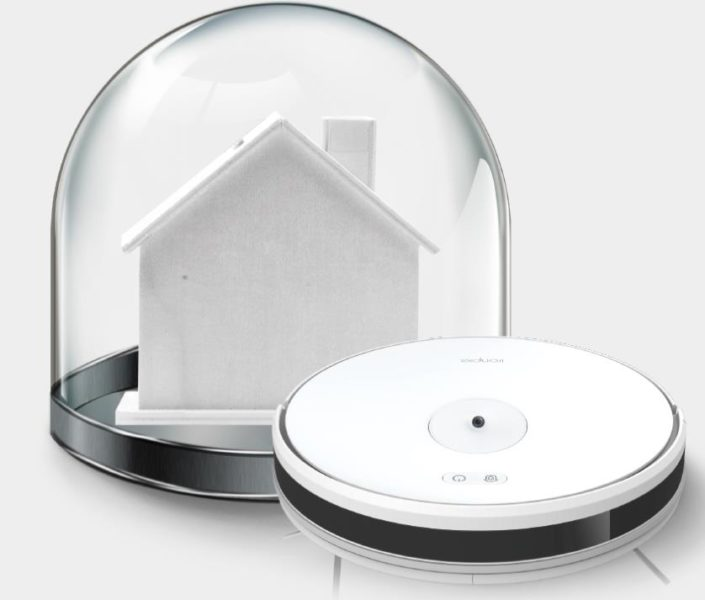 Robot aspirador Trifo Ironpie M6 y una casa de papel en una bola de cristal