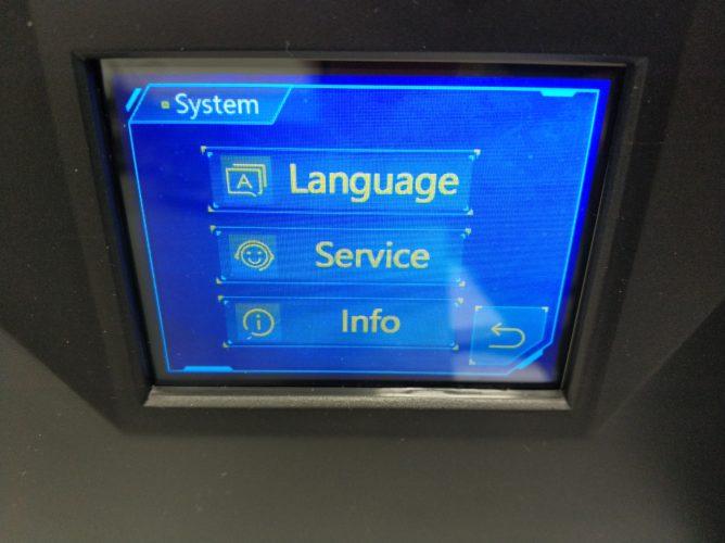 menú de sistema en la pantalla de la impresora